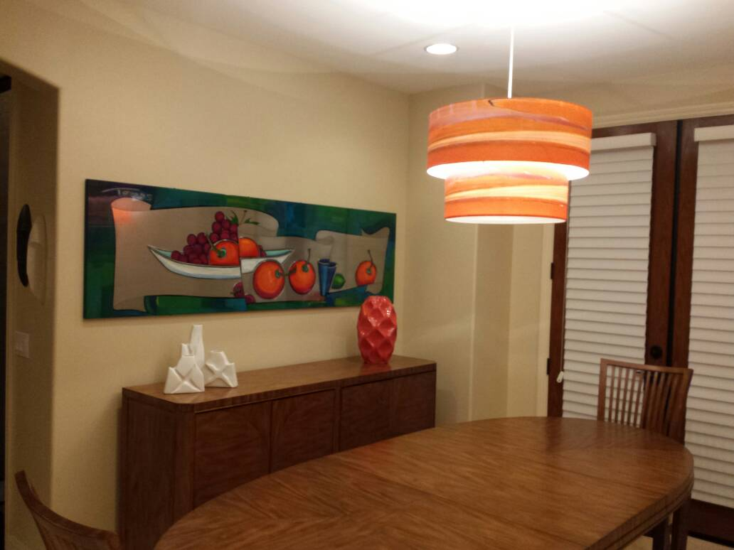 "Installation of double-shade orange ""Boardwalk"" pendant"