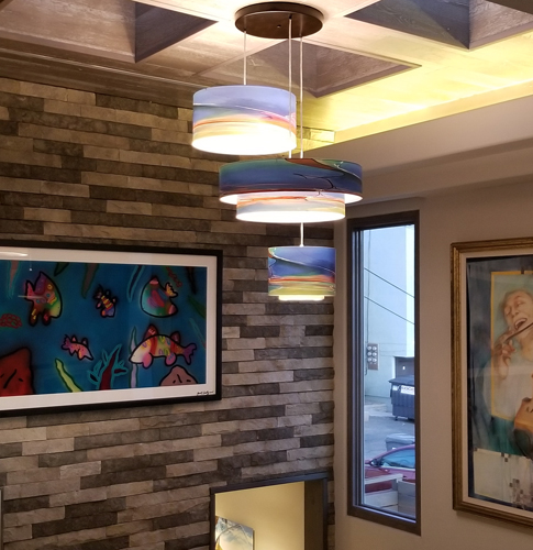 "Installation of pendant trio. 18"", 12"", 24"" configuration of single and double drum pendants in ""Whole Foods"" motif."